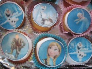fairy cakes with white icing and 'Frozen' edible transfers