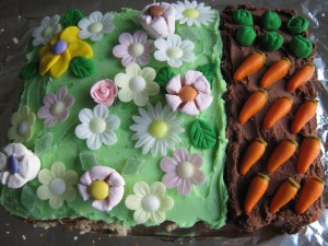 sponge cake (Victoria or chocolate) with butter cream icing and garden decorations