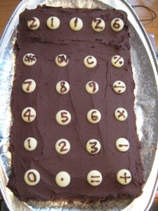 Chocolate cake with chocolate butter icing and white chocolate calculator buttons