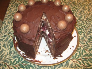 chocolate cake with cherries and cream