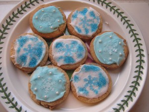golden cookies with icing, snowflakes and glitter